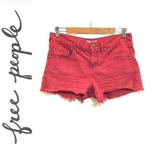 Free People red striped distressed jean shorts